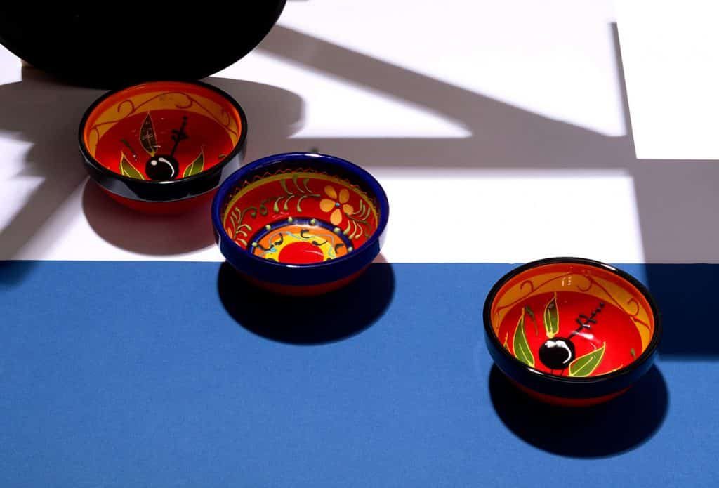 product photograph of three decorated bowls