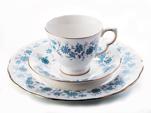 photography of ceramic cup, saucer and plate