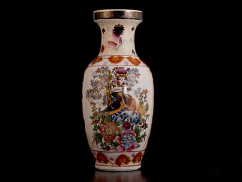 product shot of a ceramic vase against a dark background