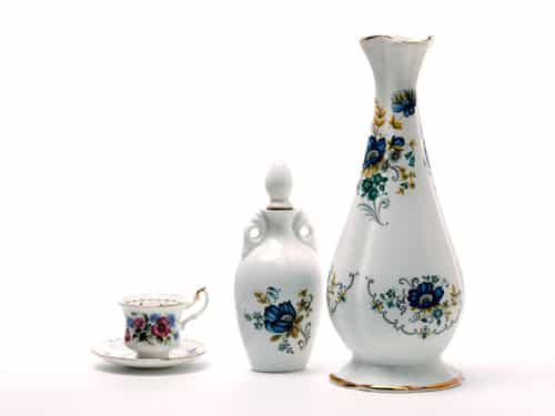 two ceramic vases and a teacup