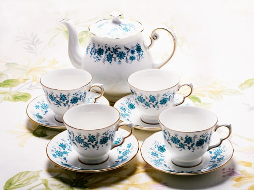 China Tea pot and four cups and saucers
