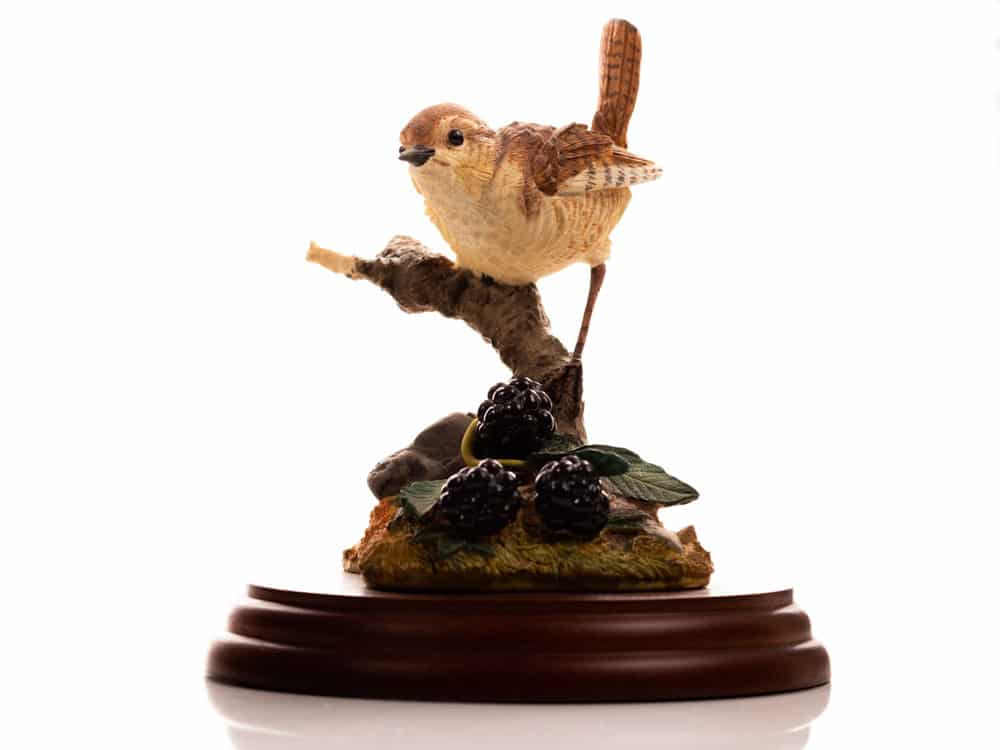 Product Shot of a ceramic wren on a branch